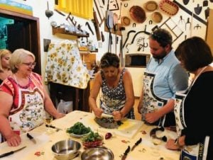 Chopping herbs at an Italian cooking class in a small village outside of Lucca, Italy