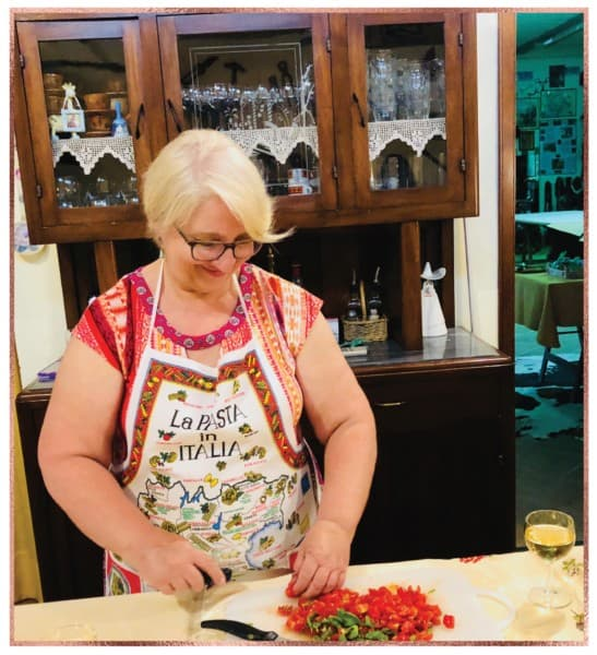 Chopping perfect, fresh tomatoes in Tuscan cooking lesson