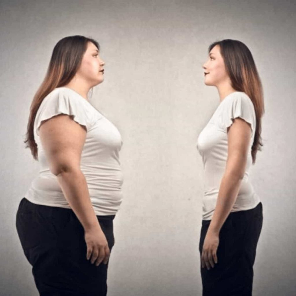 the-same-woman-in-two-different-body-sizes-staring-at-her-other-self-demonstrating-the-reality-of-distorted-postpartum-body-image
