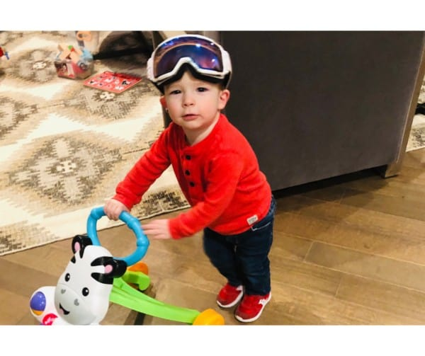 toddler-wearing-ski-goggles-pushing-cart