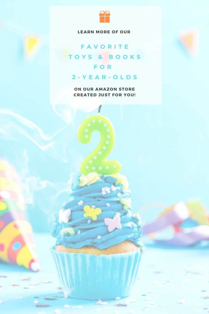 photo-of-birthday-cupcake-with-blue-icing-and-green-number-two-candle-with-text-above-it-saying-find-more-of-our-favorite-toys-and-books-for-two-year-olds-on-our-amazon-store