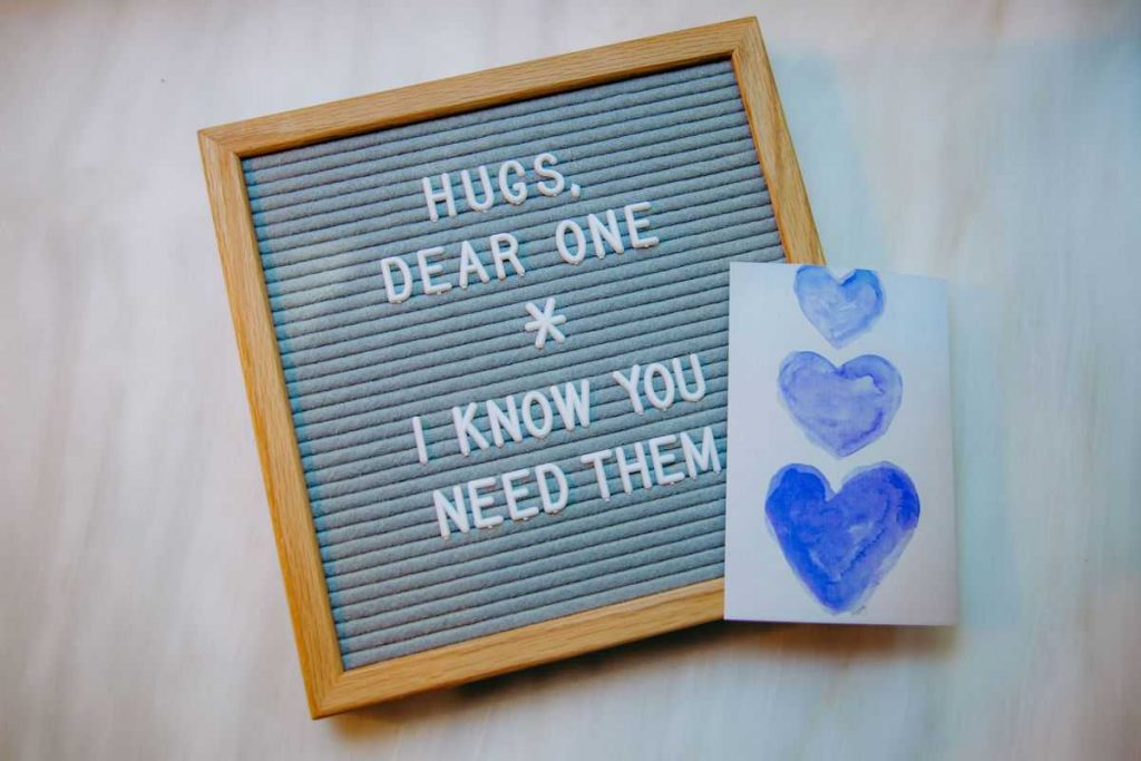 letterboard-with-art-showing-three-hearts-letterboard-reads-hugs-dear-one-I-know-you-need-them