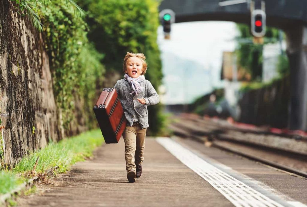 Boy running with suitcase