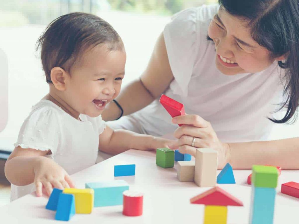 Asian mother and daughter playing with blocks in free play activity