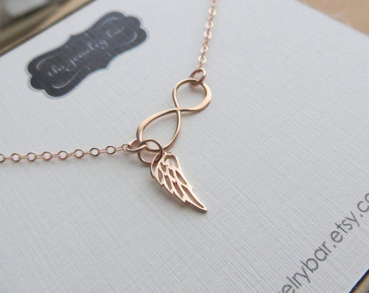a beautiful gold necklace with an infinity ring and angel wing is a lovely miscarriage gift