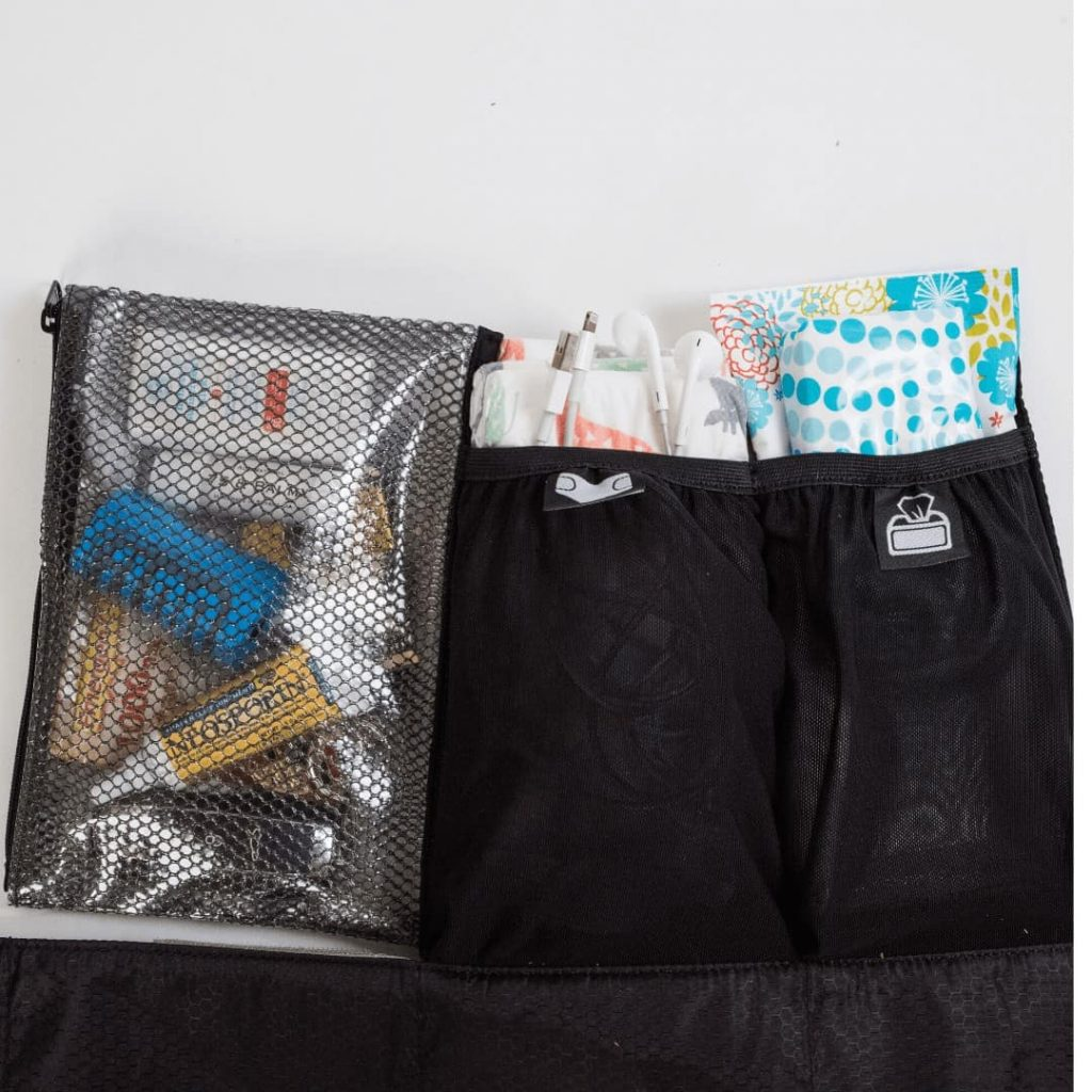 diaper-bag-alternative-called-bratpack-lying-open-showing-contents-of-inside-including-pouch-with-diapers-pouch-with-wipes-and-zipper-section-for-small-baby-necessities