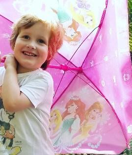 boy-with-disney-umbrella-child-with-autism