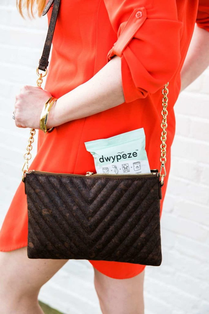 woman-holding-purse-with-dwypeze-diaper-bag-alternatve-sticking-out