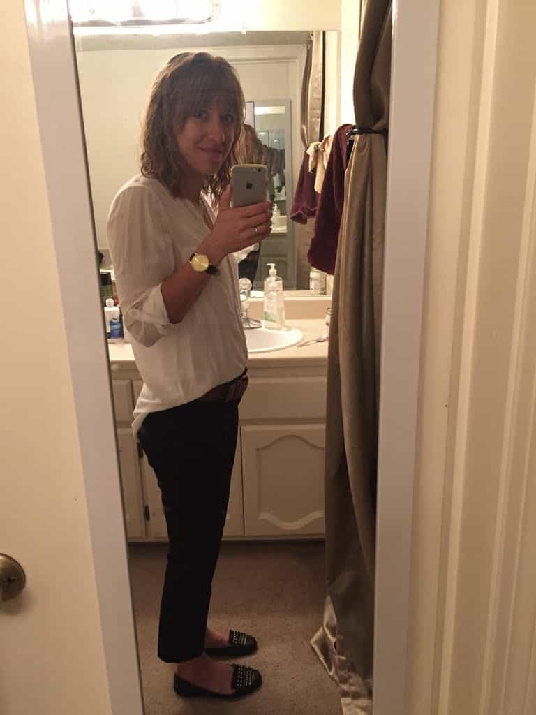 woman-standing-in-front-of-mirror-taking-photo-of-her-tiny-baby-bump-from-her-unplanned-pregnancy-3-days-before-her-miscarriage