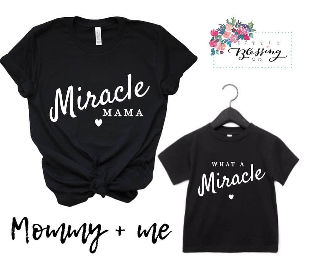 mommy-and-me-black-t-shirts-that-are-a-great-rainbow-baby-gift-one-the-adult-tshirt-says-rainbow-baby-mama-and-the-baby-shirt-says-what-a-miracle
