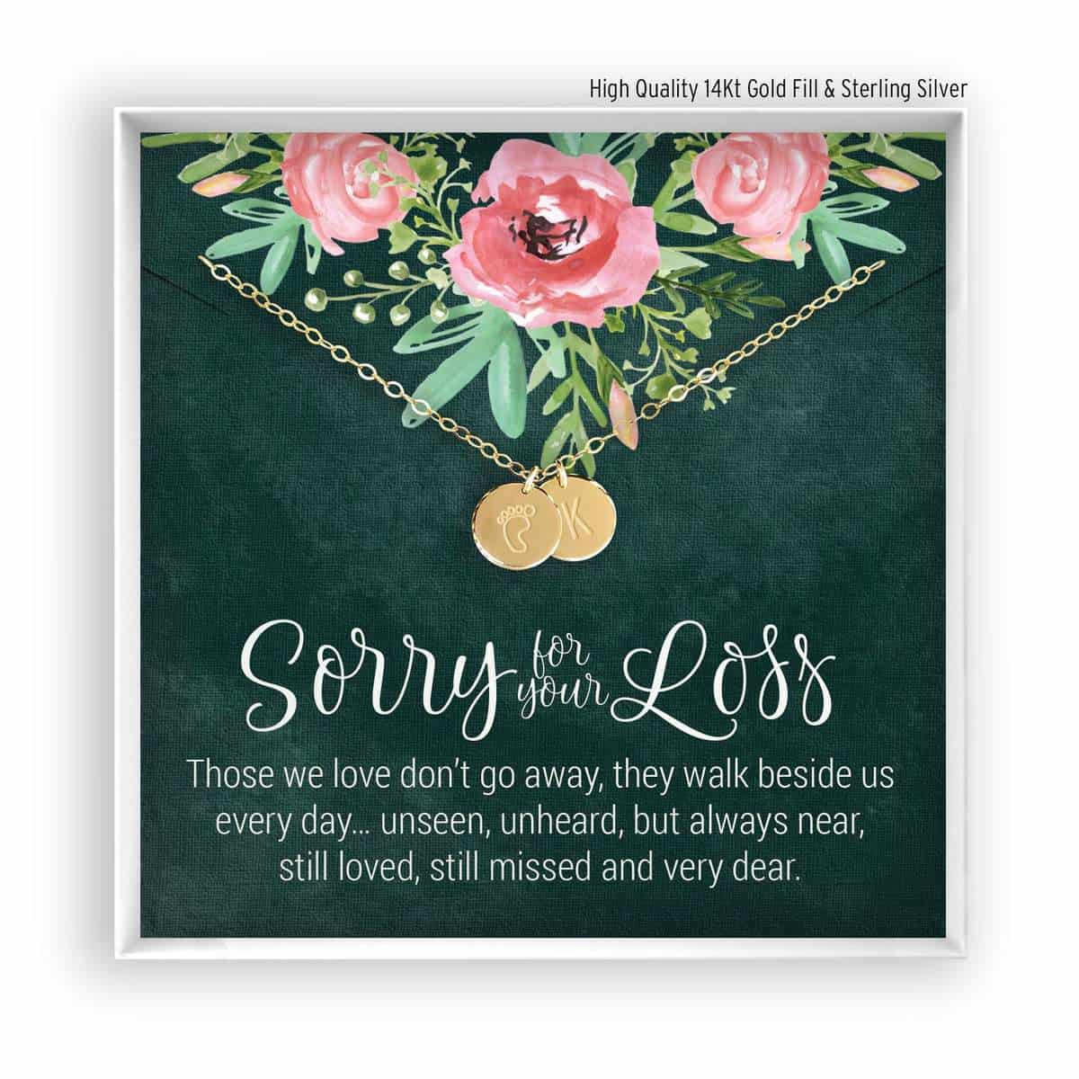 photom of miscarriage necklace on card that says sorry for your loss