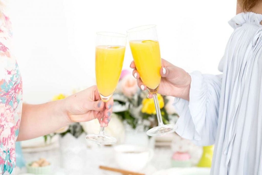 women-toasting-with-mimosas-at-shower