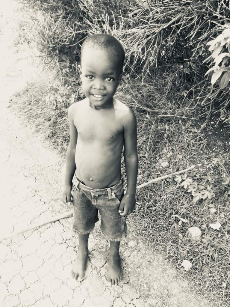 young-haitian-boy-smiles-for-camera