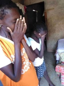 mother-and-daughter-with-hands-over-face-crying-with-relief