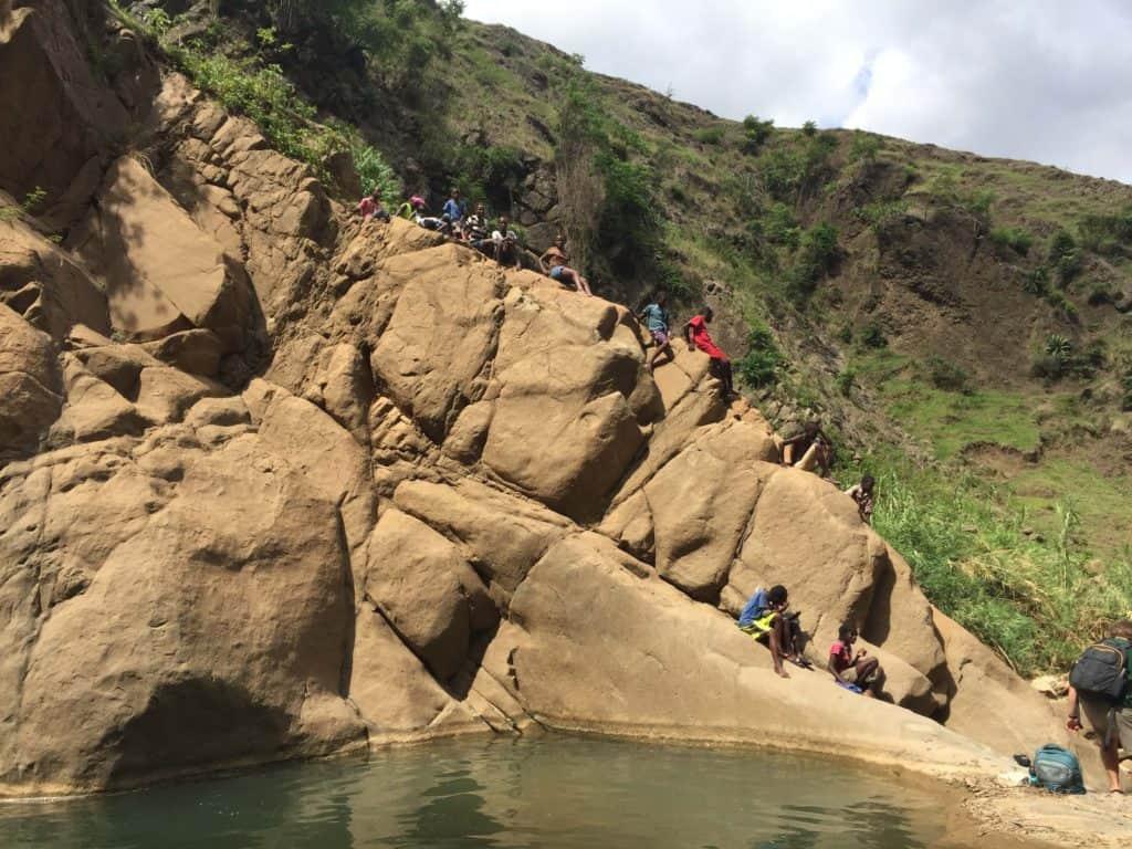 people-on-steep-rocky-cliffside
