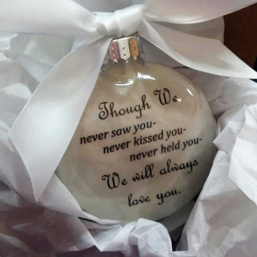 clear globe miscarriage christmas ornament with white bow that says though we never saw you kissed you held you we will always love you