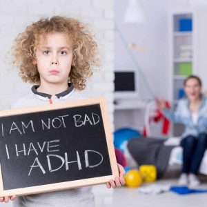 """young boy holds sign that reads """"I am not bad, I have ADHD"""""""