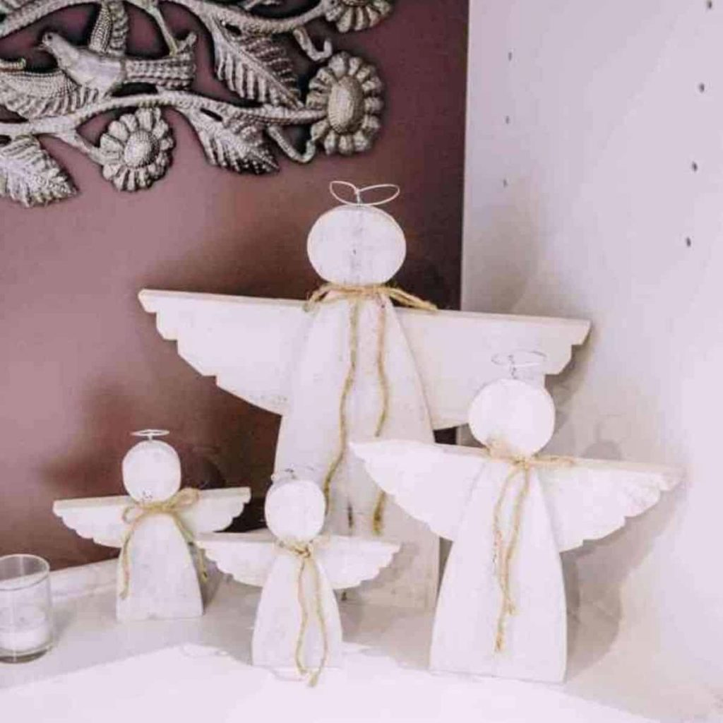 4 wooden angels miscarriage memorial placed on the mantel in the living room