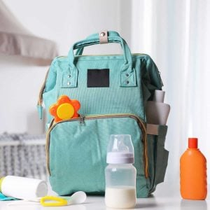 diaper bag backpack surrounded by the essentials