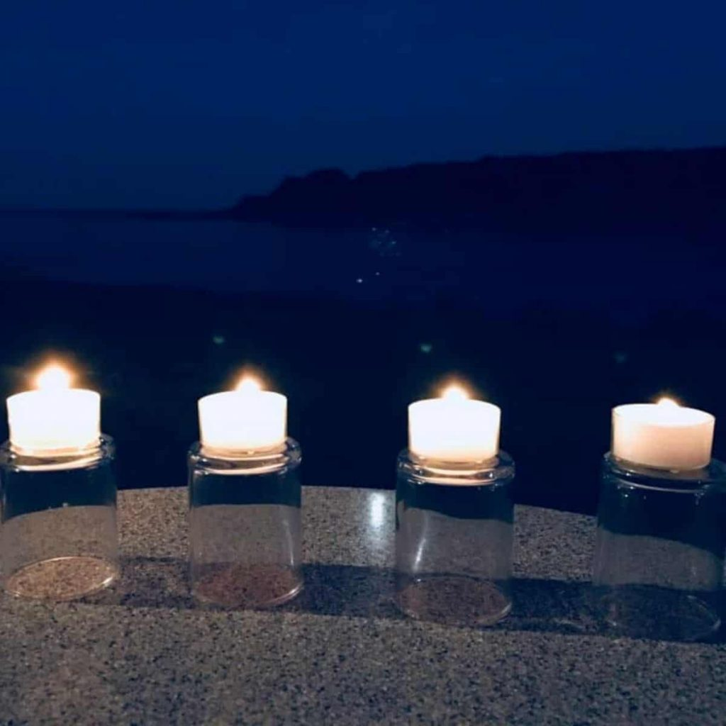 4 lit candles that represent the babies we lost to miscarriage. Candles make a great miscarriage gift.