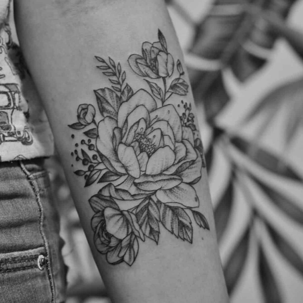miscarriage tattoo with flowers on arm