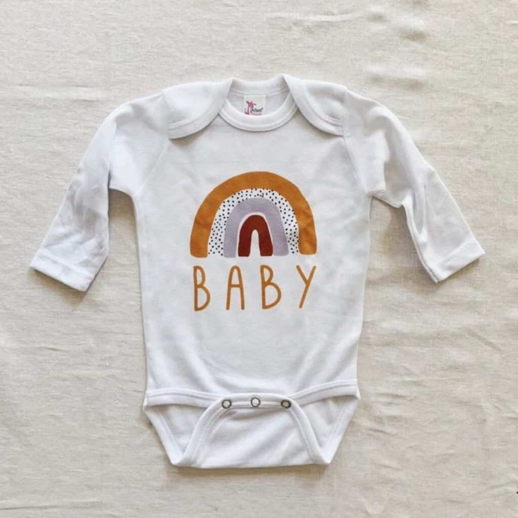 Onesie with a rainbow that says baby can be purchased on Etsy