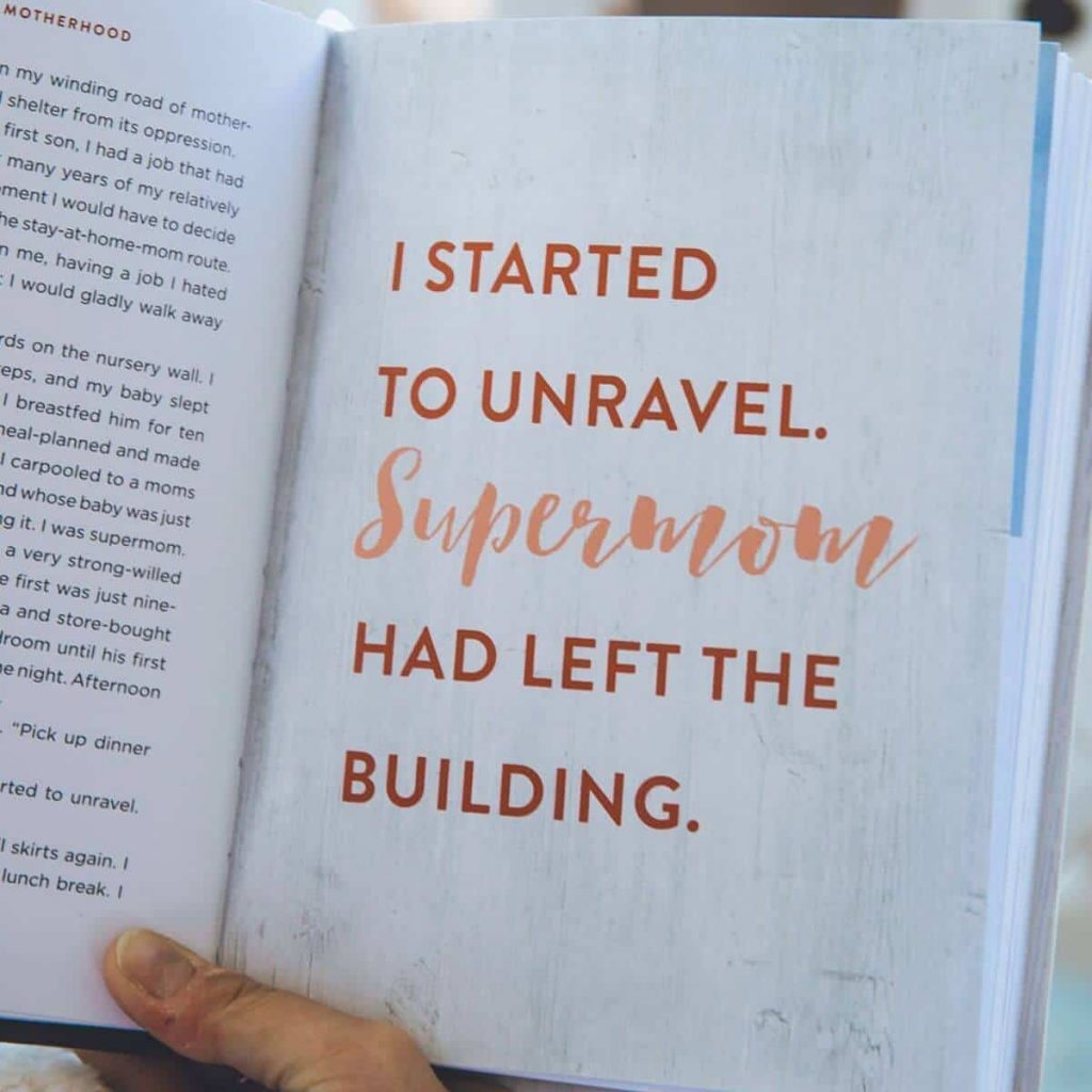 hand holding book that says I started to unravel, supermom has left the building