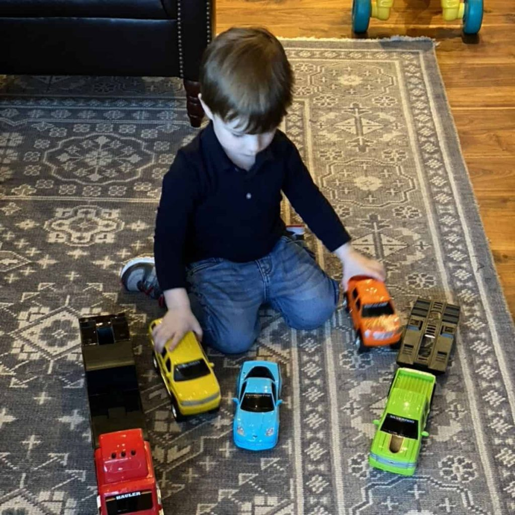 When you need ideas for activities for toddlers at home, sometimes it's best to allow them to choose. Jack loves playing with his toy cars and trucks in our living room.
