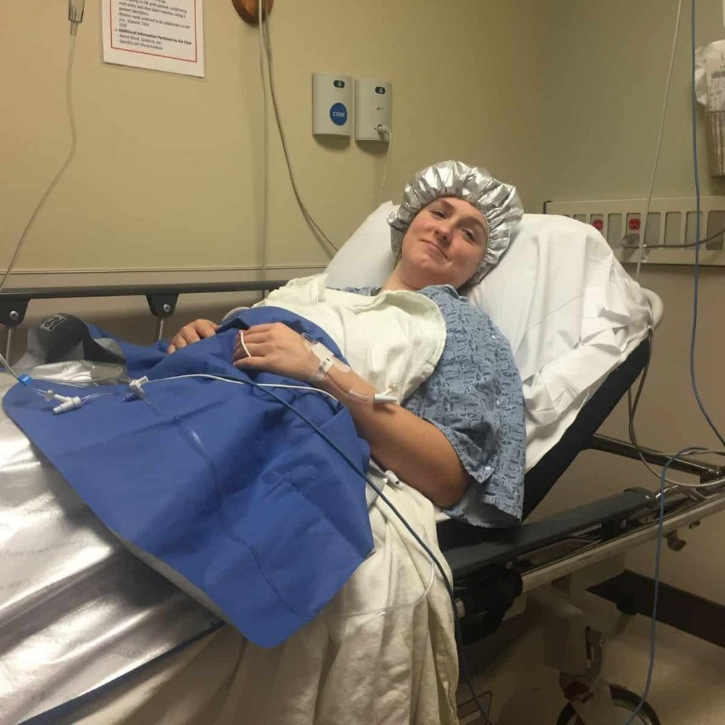 Katy, aftering being prepped for surgery, waiting in the hospital room before surgery