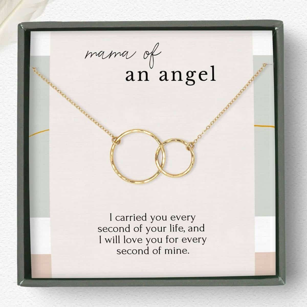 gold necklace with one larger circle looped through a smaller circle on a card that says mom of an angel