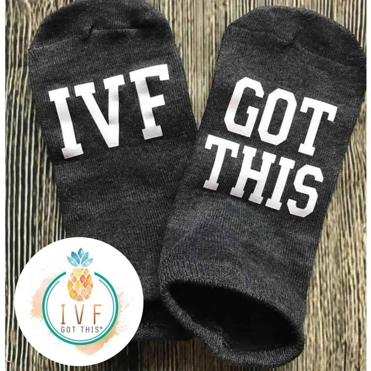 two black socks that say IVF got this