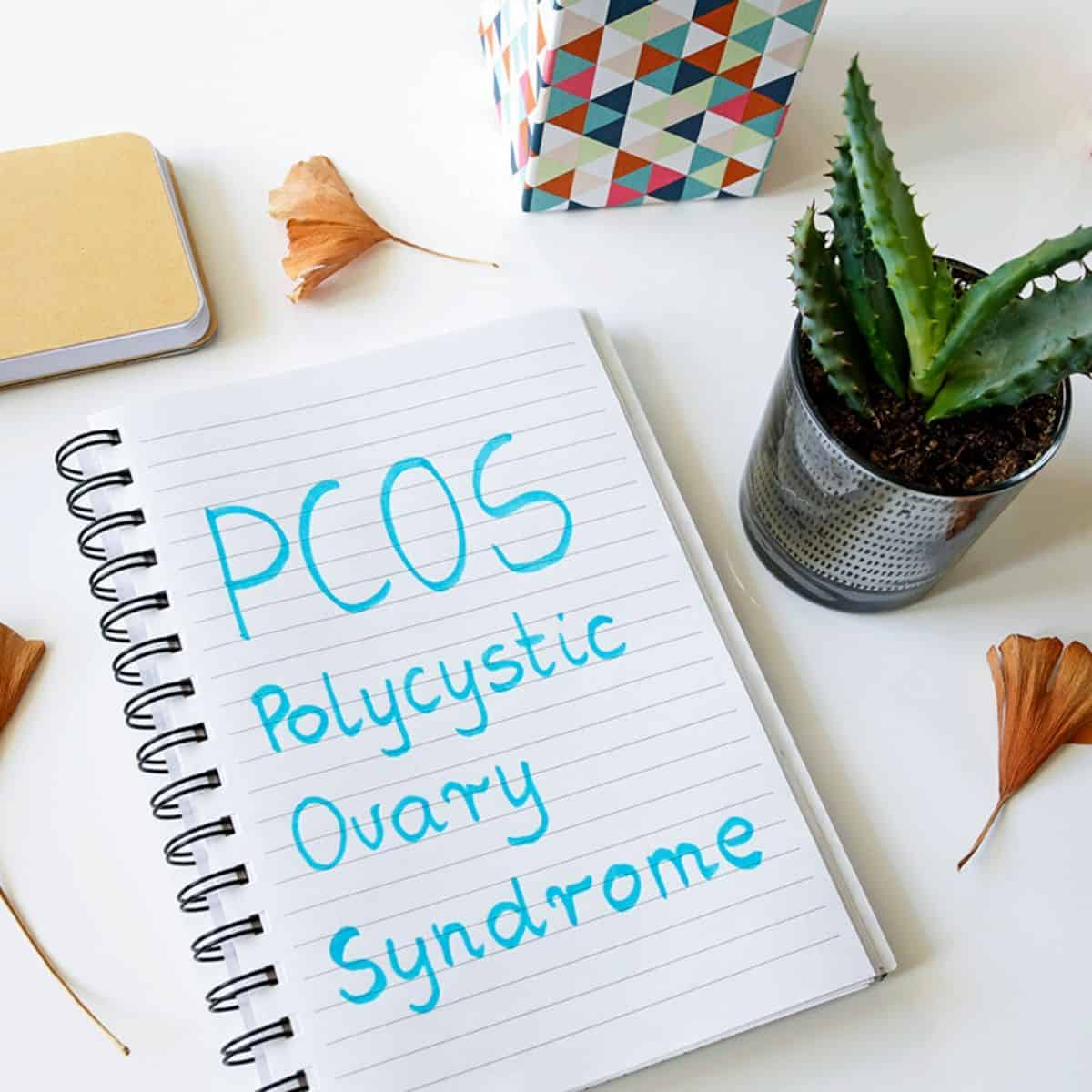 """notebook page with the words """"PCOS Polycystic Ovary Syndrome"""" written on it"""