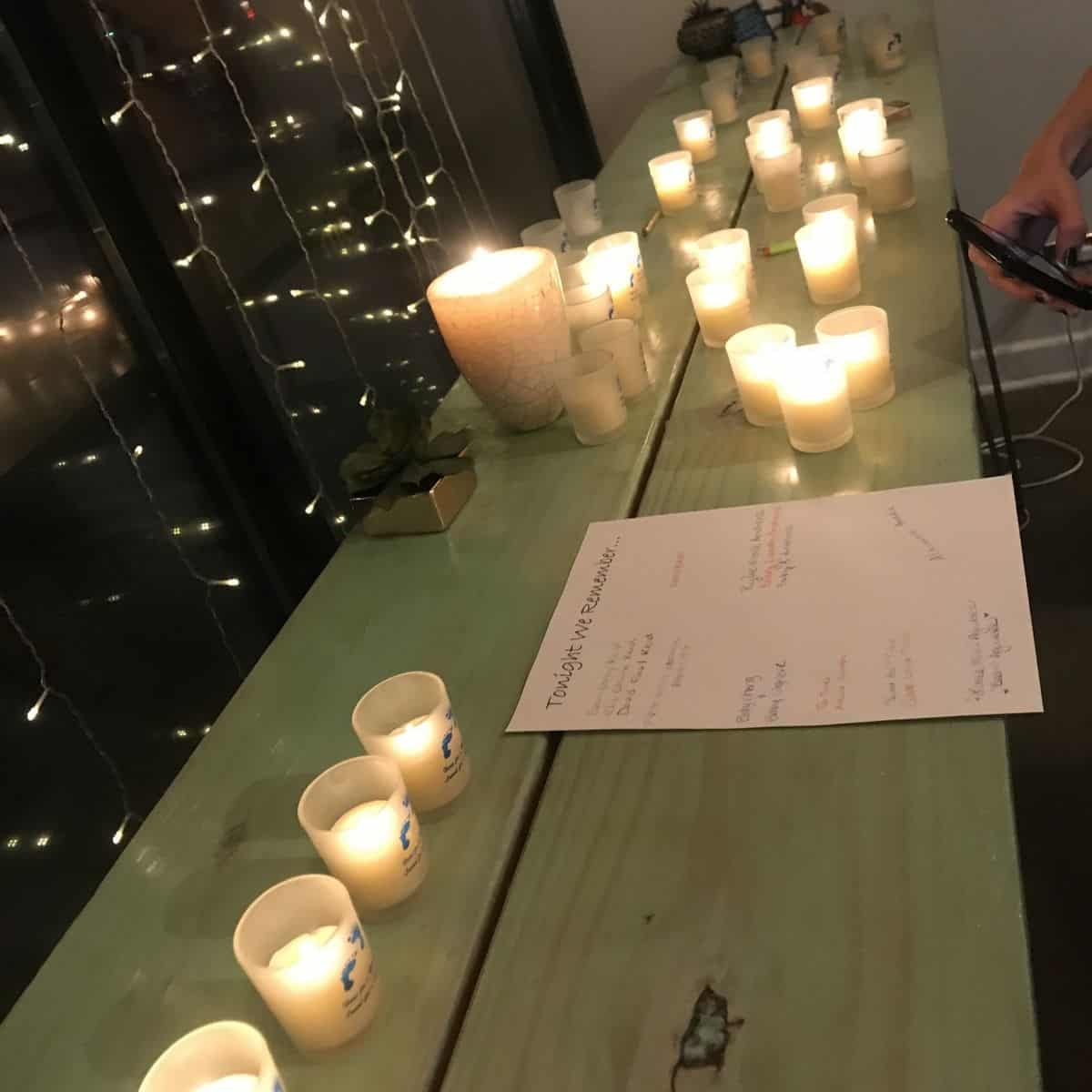 lighted candles on table in honor of Wave of Light annual event