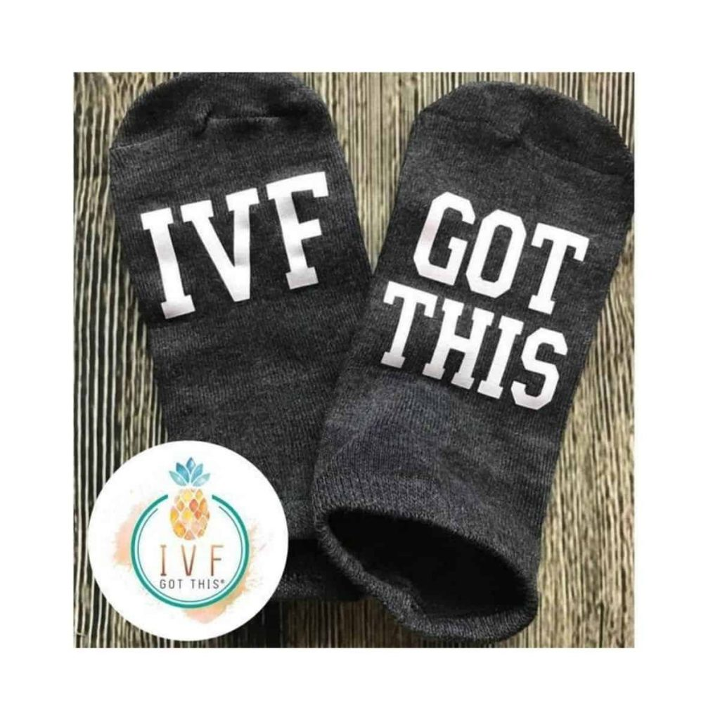 "gray socks that read ""IVF got this"""