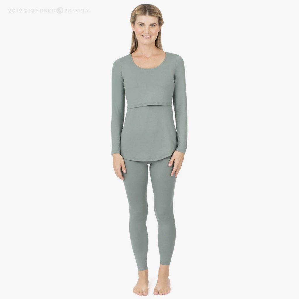 woman wearing green pajamas with an opening designed for breastfeeding
