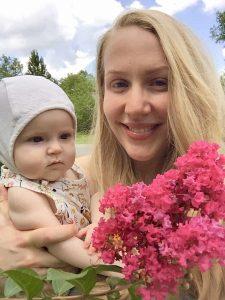 Rachel holding her daughter