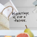 "photo of fruit and a basket with text that reads ""miscarriage is not a failture."""
