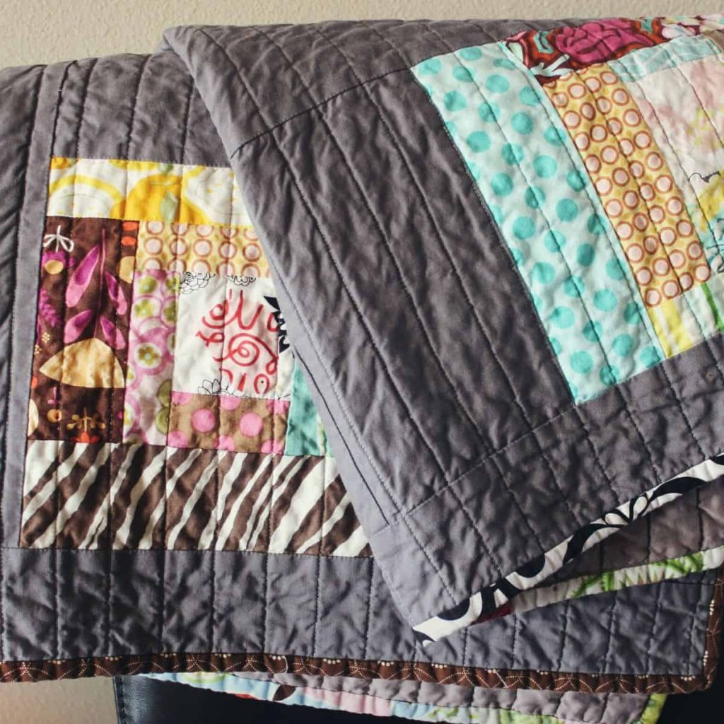 two gray quilt blankets