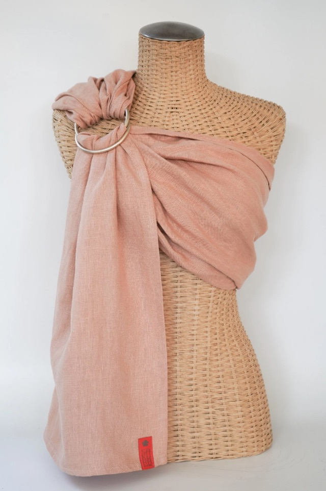 a pink ring sling displayed on a mannequin