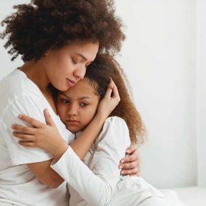 mother is hugging her daughter