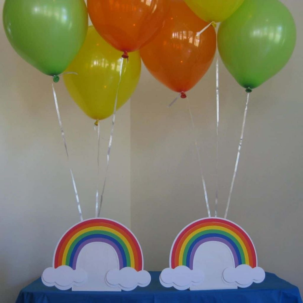 two rainbow balloon holder center pieces with six balloons attached