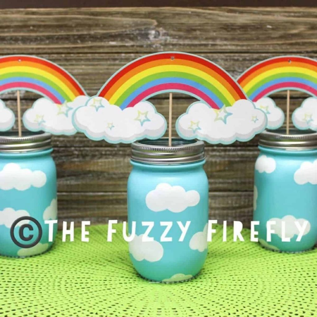 set of three rainbow cloud mason jars with rainbows on top
