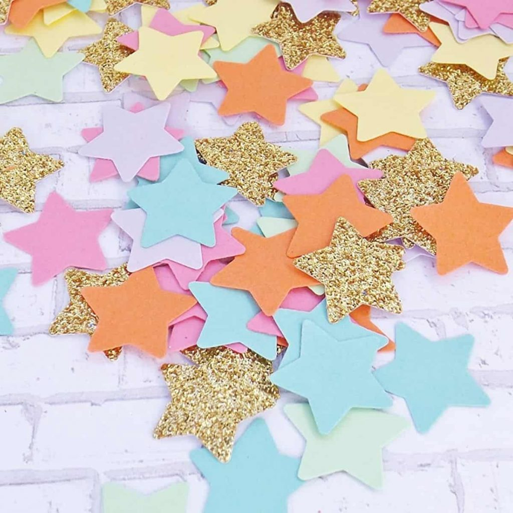 rainbow confetti stars sprawled out across tabletop