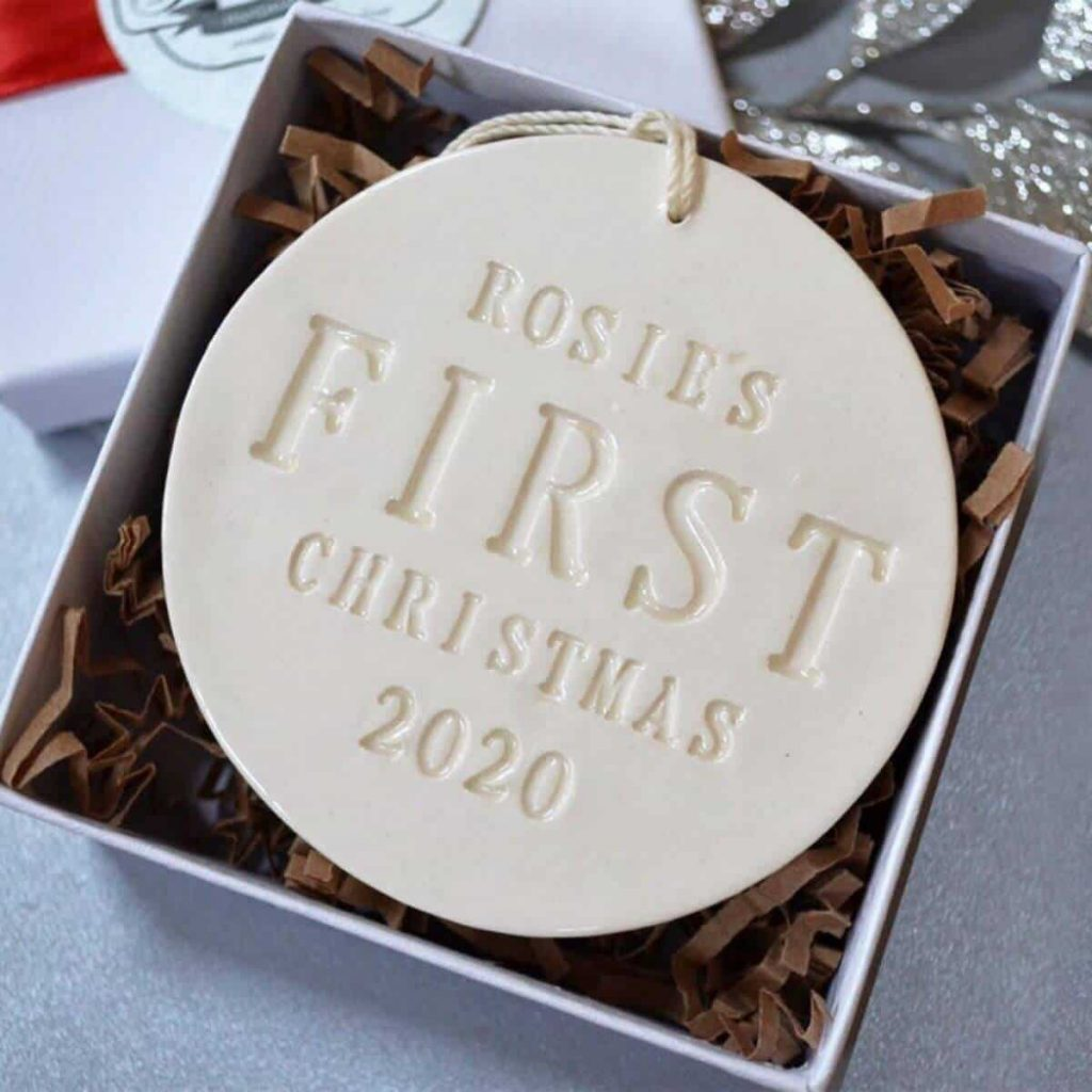 cream clay ornament in box that says Rosie's first Christmas 2020