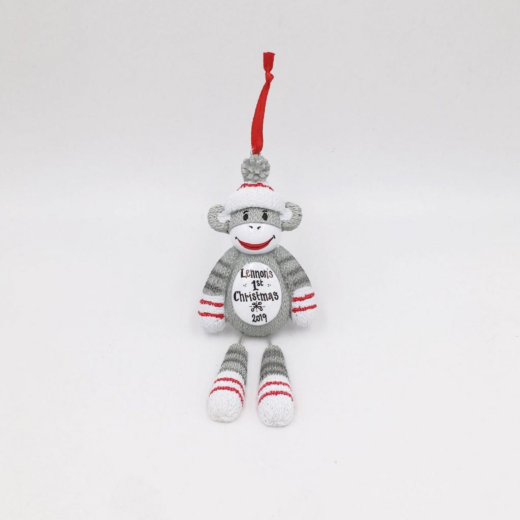 sock monkey christmas ornament that says baby's first christmas