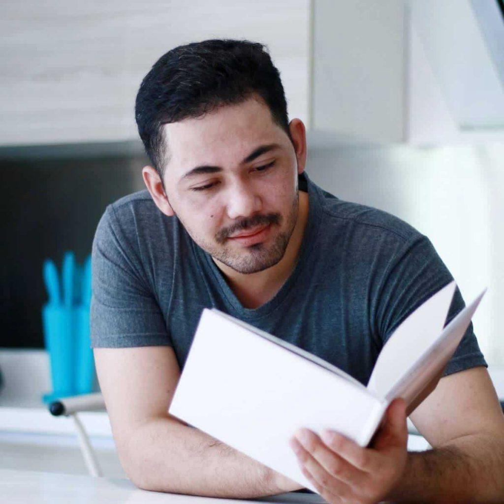 Man reading book about fertility