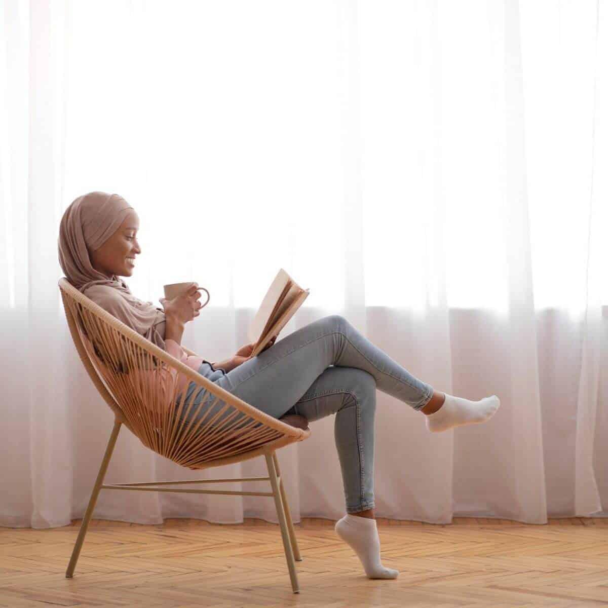 Woman reading books about fertility