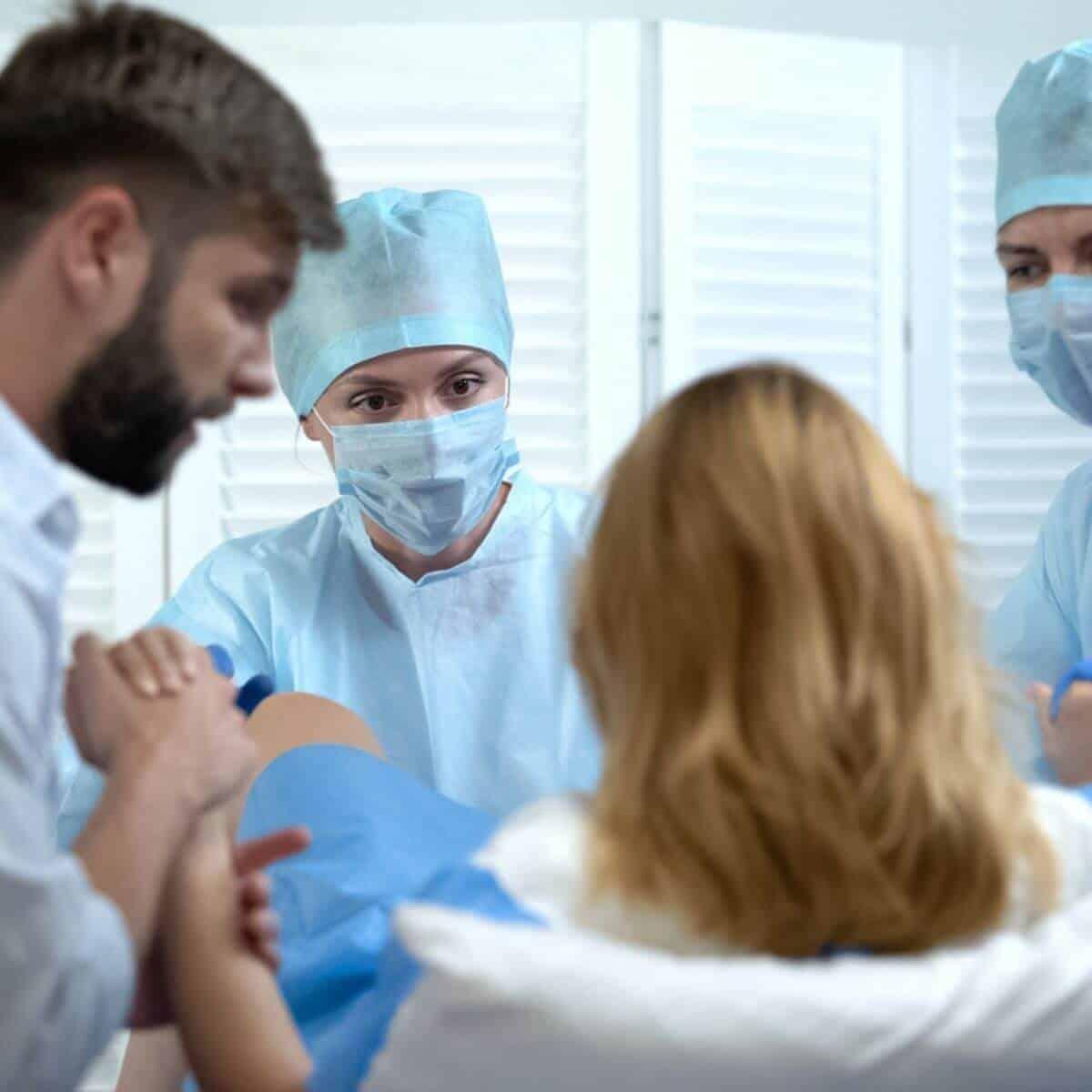 Woman in labor, the husband stitch