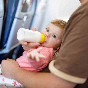Baby bottle feeding on a plane