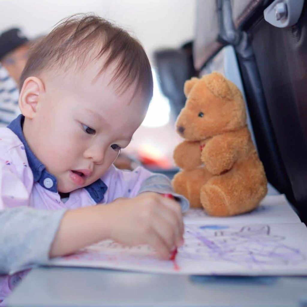 Baby doing activities on a plane